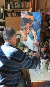 Mike Kinane the artist in his studio painting